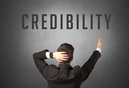 Rear view of a businessman with CREDIBILITY inscription, powerfull business concept
