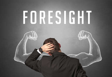 Rear view of a businessman with FORESIGHT inscription, powerfull business concept