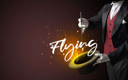 Magician is showing magic trick with Flying inscription, traveling concept