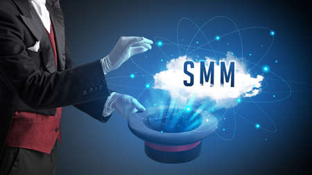 Magician is showing magic trick with SMM abbreviation, modern tech concept