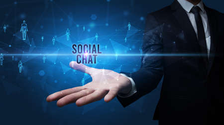 Elegant hand holding SOCIAL CHAT inscription, social networking concept