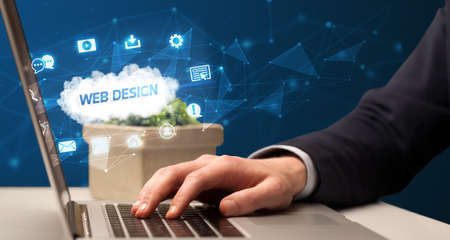 Businessman working on laptop with WEB DESIGN inscription, modern technology concept