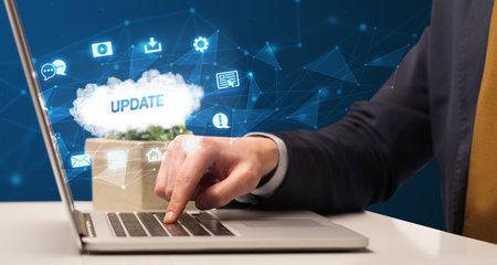 Businessman working on laptop with UPDATE inscription, modern technology concept Zdjęcie Seryjne