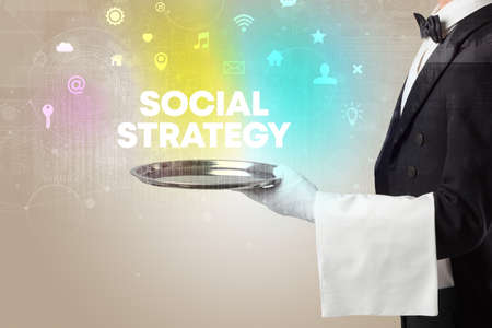 Waiter serving social networking with SOCIAL STRATEGY inscription, new media concept