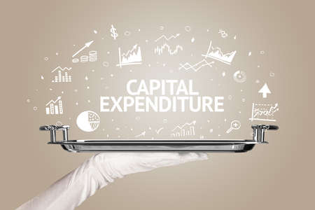 Waiter serving business idea concept with CAPITAL EXPENDITURE inscription