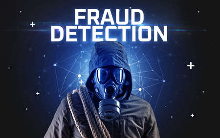 Mysterious hacker with FRAUD DETECTION inscription, online attack concept inscription, online security concept