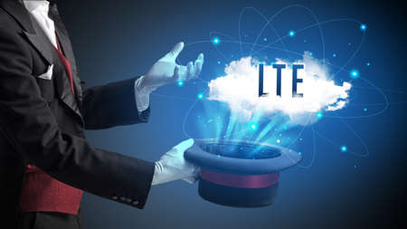 Magician is showing magic trick with LTE abbreviation, modern tech concept