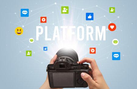 Using camera to capture social media content with PLATFORM inscription, social media content concept