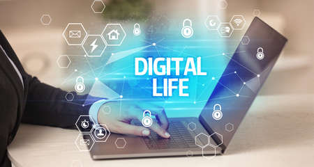DIGITAL LIFE inscription on laptop, internet security and data protection concept, blockchain and cybersecurity Reklamní fotografie