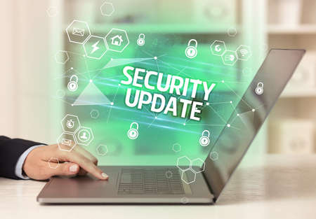 SECURITY UPDATE inscription on laptop, internet security and data protection concept, blockchain and cybersecurity