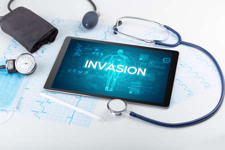 Tablet pc and doctor tools with INVASION inscription