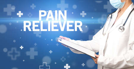 doctor writes notes on the clipboard with PAIN RELIEVER inscription, first aid concept Stock fotó