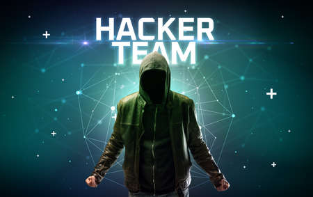 Mysterious hacker with HACKER TEAM inscription, online attack concept inscription, online security concept