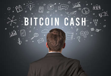 Rear view of a businessman with BITCOIN CASH inscription, modern business concept