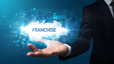 Hand of Businessman holding FRANCHISE inscription, successful business concept Imagens
