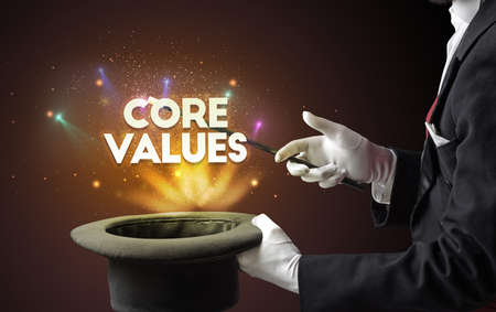Illusionist is showing magic trick with CORE VALUES inscription, new business model concept