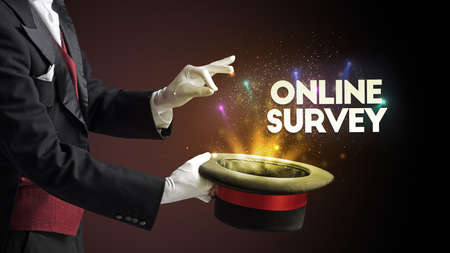 Illusionist is showing magic trick with ONLINE SURVEY inscription, new business model concept