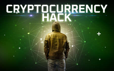 Mysterious hacker with CRYPTOCURRENCY HACK inscription, online attack concept inscription, online security concept