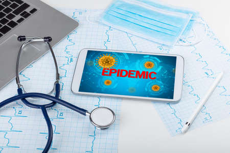 Close-up view of a tablet pc with EPIDEMIC inscription, microbiology concept Stock Photo