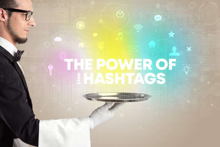 Waiter serving social networking with THE POWER OF #HASHTAGS inscription, new media concept