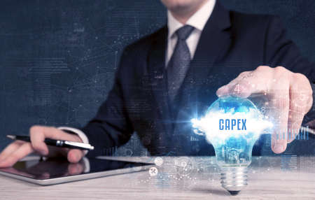 Businessman holding a light bulb, business concept Standard-Bild