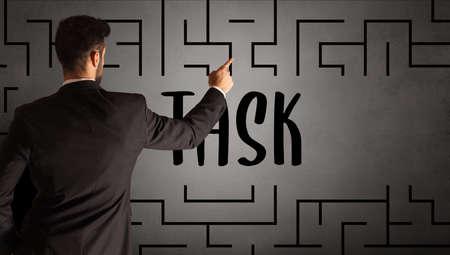 businessman drawing maze concept