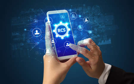Hand using smartphone with technology concept. RCS