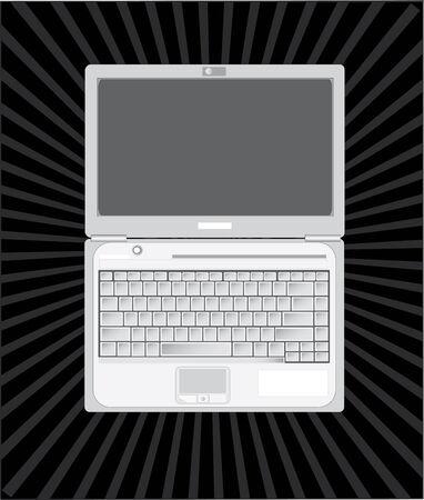 El ordenador port�til abierto contra un fondo oscuro.