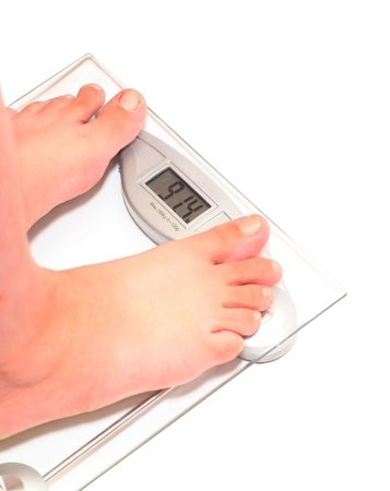 91,4 time to lose weight. Womans feet on scale.  Stock Photo