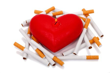 shorten: Burning candle in the shape of the heart. Cigarettes shorten life. Stop smoking concept.