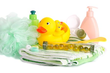 Bath accessories - Soft towels, plastic toys, liquid soap, washcloths, bath beads, shampoo, and more. A lot of light on a white background (high key) photo