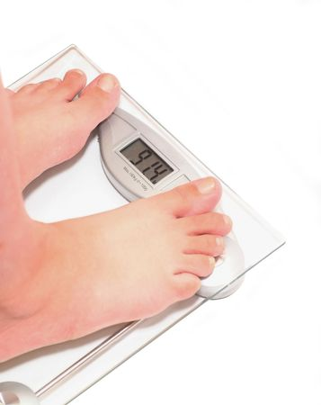 91,4 kg - time to lose weight. Womans feet on scale