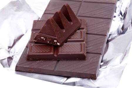 Three types of dark chocolate lying on the foil. Stock Photo - 8126081