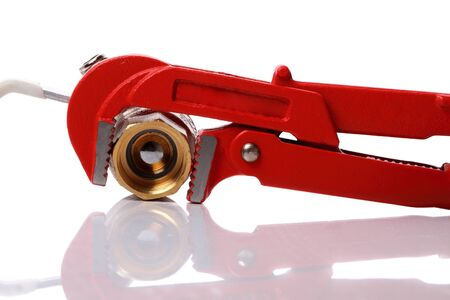 Red wrench isolated on white background. photo