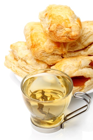 french pastry: Cup of green tea and french pastry homemade isolated on white background