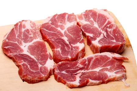 marbled: Chunks of fresh marbled meat on a cutting board