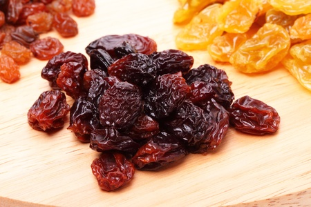 raisin: Heap large raisins on a cutting board