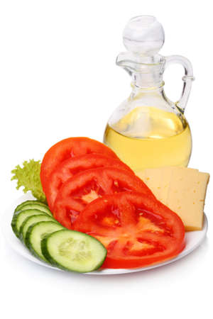 coking: Sliced tomato, cucumber, cheese and sunflower oil in the jug isolated on a white background