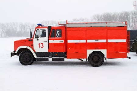 brigade: Fire truck in the winter. Is heavy snow Stock Photo
