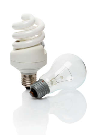making a save: Energy saving lamp and bulb isolated on white background