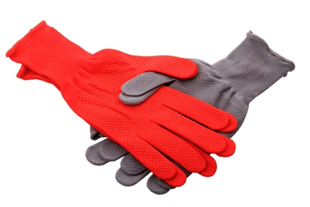Red and gray gloves isolated on white background photo
