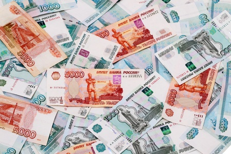 corresponds: Russian Paper Money 5000, and 1000 rubles covering the whole frame. 1000 rubles corresponds to 33 U.S. dollars. Stock Photo