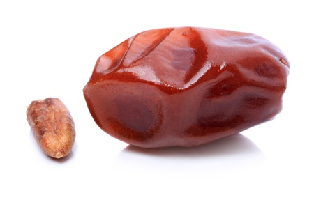 Dried dates and his seed on a white background Stock Photo - 9984789