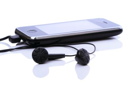 fm: Electronic organizer with FM radio and black headphones isolated on white background