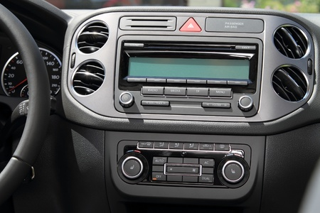 car accessory: Vehicle instrument panel console and car stereo radio.