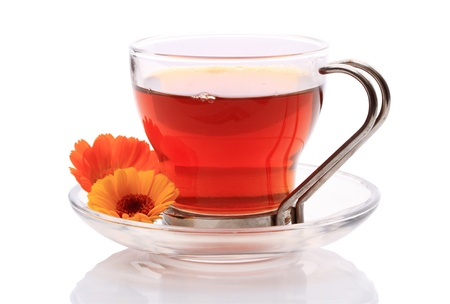 peo: Herbal tea in a glass cup isolated on a white background