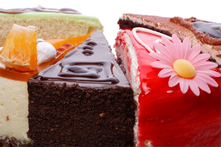 Five different pieces of cake close-up. Isolated on white background. Stock Photo - 10064819
