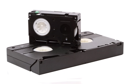 vcr: Format VHS. Household standard video released in 1976, better known as VHS (Video Home Standart) is the standard for VCRs. Isolated on white background Stock Photo