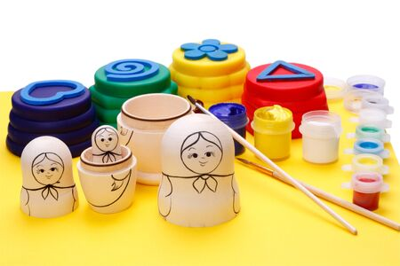 Coloring figures of wood and clay. Russian nesting dolls (Matryoshka)  photo