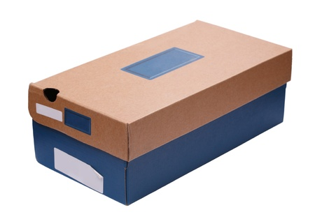 frugality: Shoe box made of rough paper and card. Concepts of recycling, re-use of objects, frugality, shopping. Add your own copy. Isolated on white background